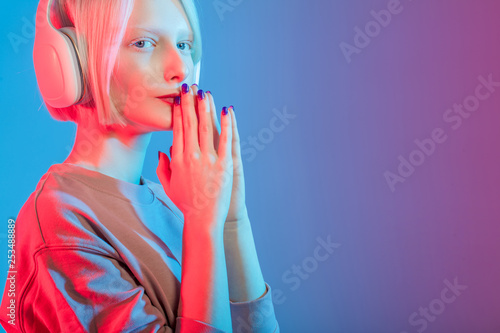 young unhappy girl trying to reduce her stress and negative emotions, close up photo. copy space, isolated blue background - 253488889