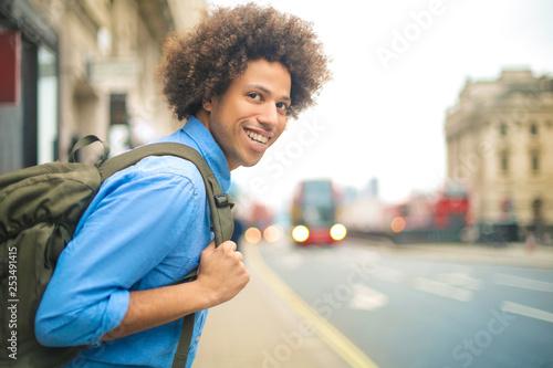 Cheerful guy walking around London