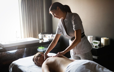 Masseur doing massage on woman body in the spa salon. Beauty treatment concept. © nd3000