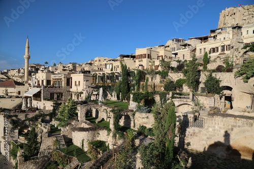 View of ancient Nevsehir cave town and a castle of Uchisar dug from a mountains in Cappadocia, Central Anatolia,Turkey - 253497048