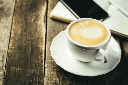 BUsiness morning concept - coffee, notebook, phone, rustic wood background - 253526641
