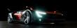 Leinwanddruck Bild - Moderner Sportwagen bei Nacht mit LED Scheinwerfern