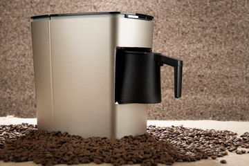 New Turkish coffee maker over coffee beans