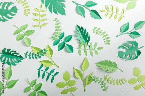 top view of paper plants on grey background