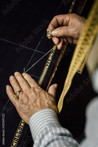 Craftsman tailor at work in the workshop - 253597225
