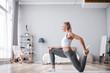 Leinwanddruck Bild - Sporty beautiful woman stretching exercising at home.