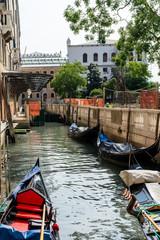 The gondolas parked near bridge in Venice, Italy