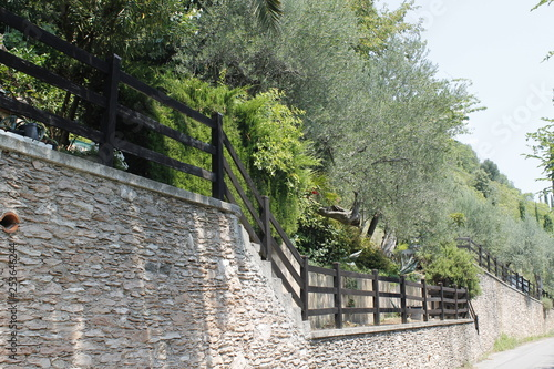 road with ancient wall in north Italy - 253646244
