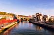 Leinwanddruck Bild - view of guggenheim museum on the banks nervion river