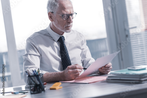 Businessman checking a document