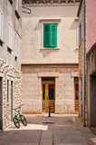 Street with green bicycle and window shutters, Vela Luka, island of Korcula, Croatia