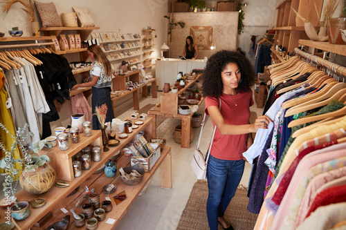 3b58684d17633 Customers Browsing In Independent Clothing And Gift Store | Buy ...