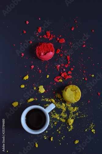 White Cup with fragrant coffee on the background of beautiful pieces of cookies scattered on the table  © Viacheslav