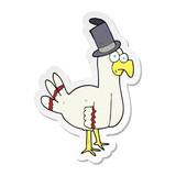 sticker of a cartoon bird wearing top hat