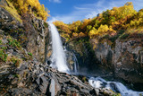 Waterfall in the mountains in the fall. Chuchhursky waterfall, Dombay, Caucasus