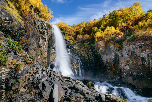 Waterfall in the mountains in the fall. Chuchhursky waterfall, Dombay, Caucasus - 253812643