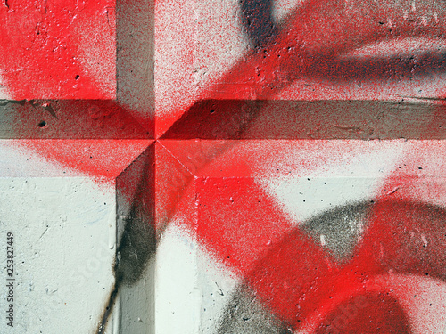 Fragment of a concrete wall with black and red paint