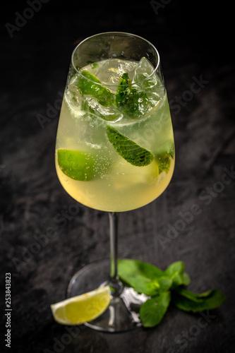 Leinwanddruck Bild Glass of Hugo cocktail