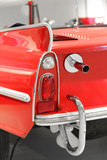 Part of red oldtimer with rear light and exhaust