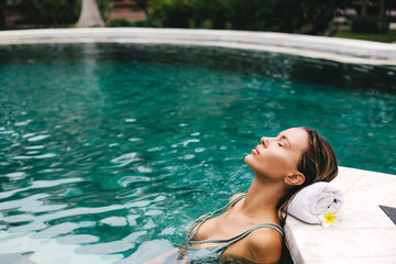 Woman relaxing in swimming pool © Alena Ozerova