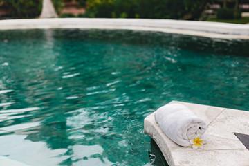 Towel and flower in luxury spa jacuzzi pool © Alena Ozerova