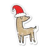 distressed sticker of a cartoon christmas reindeer