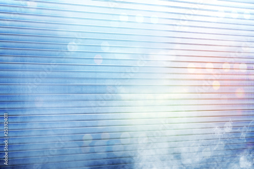 White roller shutter door with smoke and colorful light reflection - 253924011