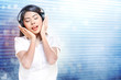 Pretty asian woman in white shirt listening music with headphones