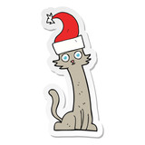 sticker of a cartoon cat in christmas hat