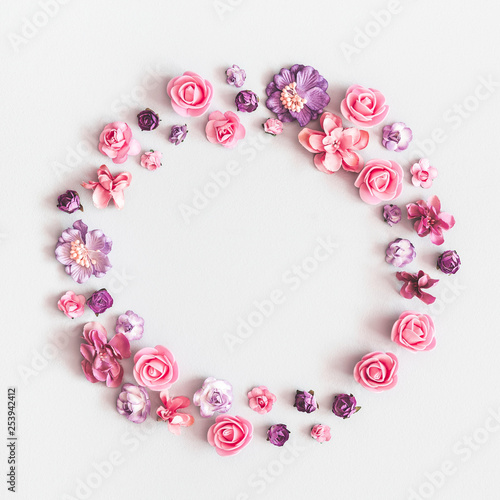 Leinwandbild Motiv Flowers composition. Wreath made of purple and pink flowers on pastel gray background. Flat lay, top view, copy space, square
