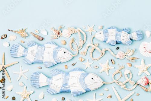 Leinwandbild Motiv Decorative fish with Seashells and starfish on a pastel background. Summer time concept. Nautical pattern.