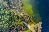 Fototapeta Do pokoju - Flying above wonderful lake and forest in Europe © shaiith