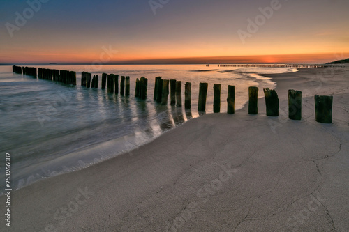 Beautiful sandy beach with a wooden breakwater, Baltic Sea, Poland © janmiko