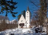 Front view of catholic church in ski resort Tatrzanska Lomnica, Slovakia