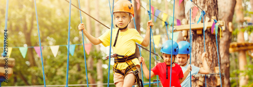 Active children's recreation. Climbing the rope park - 253976674