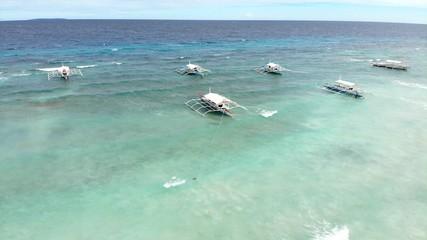 vue aerienne, mer et bateaux, philippines © alexandra