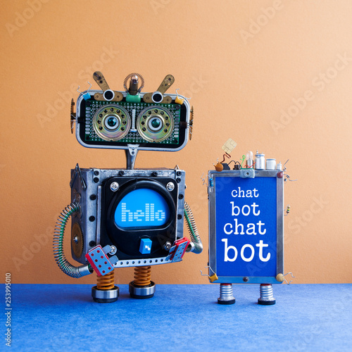 Leinwanddruck Bild Chatbot artificial intelligence poster. Creative design robot and smartphone gadget with message Chat Bot on blue screen. Modern electronic marketing communication concept. Brown wall blue floor