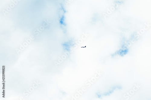 obraz PCV Military fighter in the blue sky with white clouds