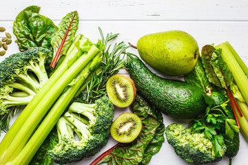 Green food background. Healthy green vegetables and fruits, top view.