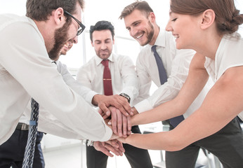 happy colleagues connects their hands together