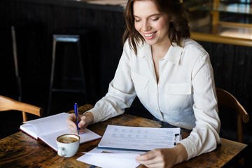 Confident businesswoman working with documents