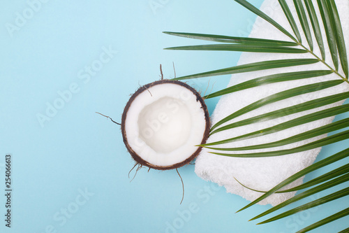 Spa still life of organic cosmetics, coconut on a blue background, body care concept, Spa setting and health care items, towel - 254066613