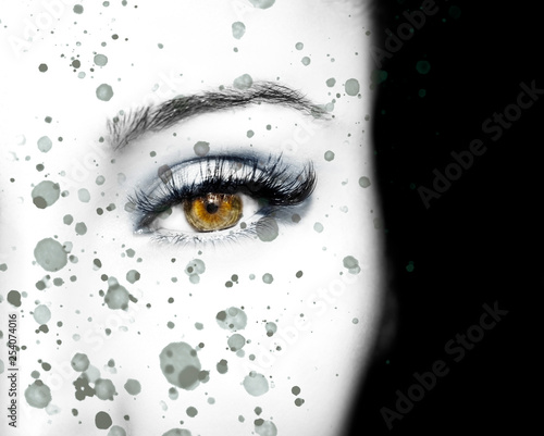 A beautiful insightful look eye with abstract spots. Close up shot - 254074016