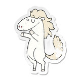 distressed sticker of a cartoon horse