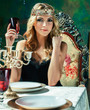 Leinwanddruck Bild - young blond woman wearing crown in fairy luxury interior with empty antique frames total wealth, rich lifestyle concept close up