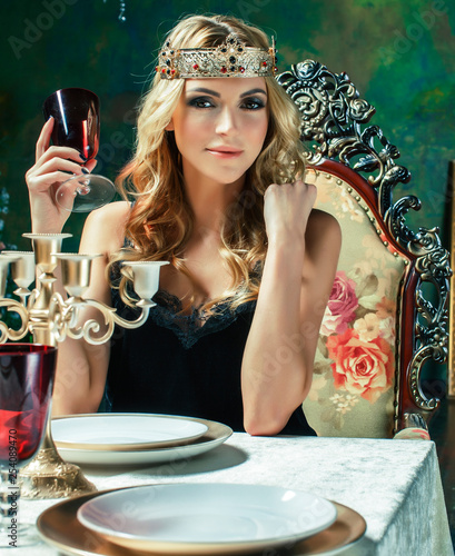 Leinwandbild Motiv young blond woman wearing crown in fairy luxury interior with empty antique frames total wealth, rich lifestyle concept close up