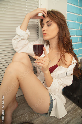 woman with red wine - 254093887