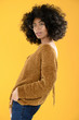 African American Woman in Glasses with Afro on Yellow