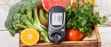 Glucose meter with healthy fruits and vegetables. Checking sugar level, diabetes, diet and slimming concept
