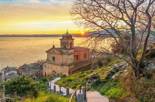 Leinwanddruck Bild Trevignano Romano (Italy) - A nice medieval town on Bracciano lake, province of Rome, Lazio region, here at sunset